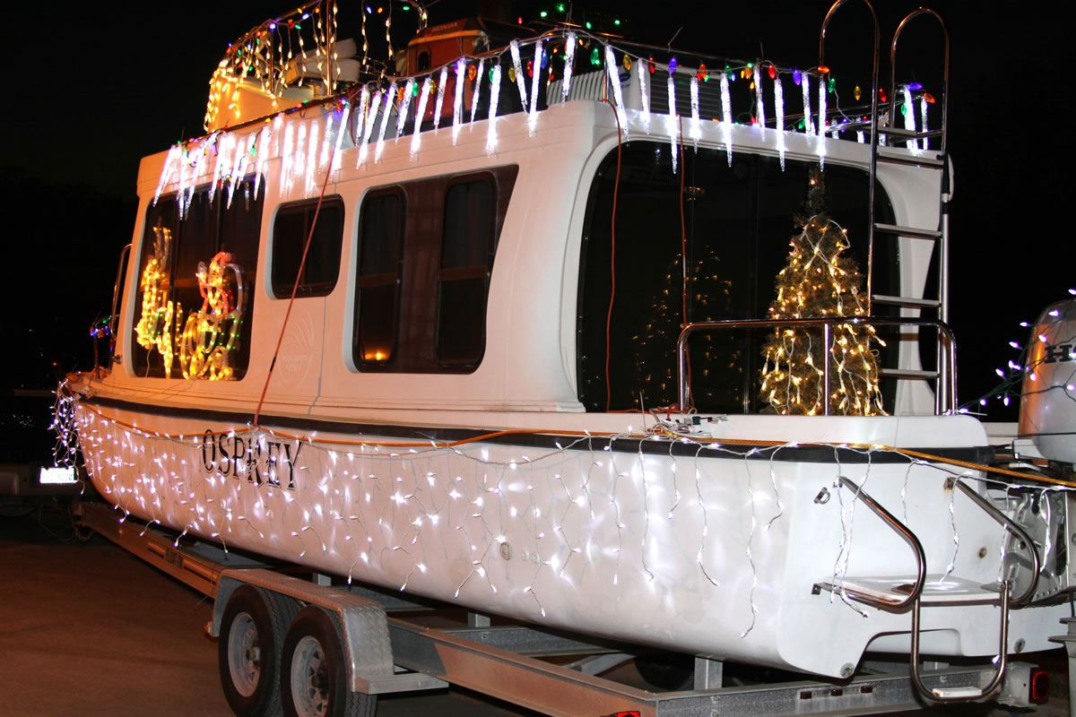 Boat on Trailer Decorated in Lights and Christmas Decorations
