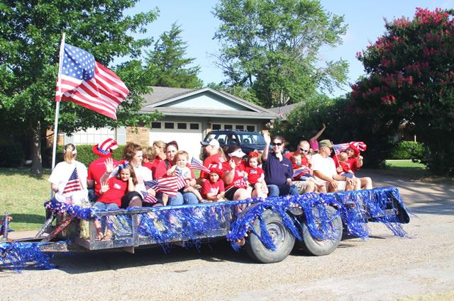 Group of Men, Women, and Children in Parade Float