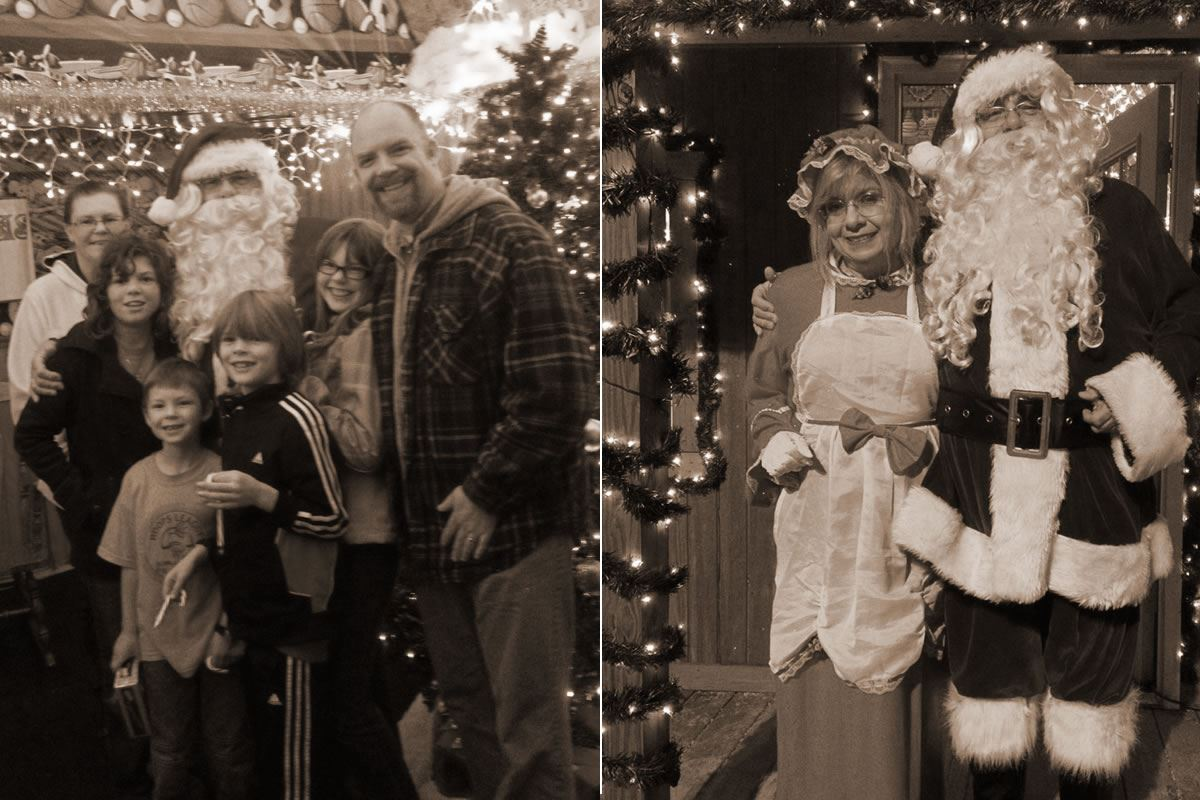 Family Poses with Santa Next to Santa and Mrs. Claus Photo