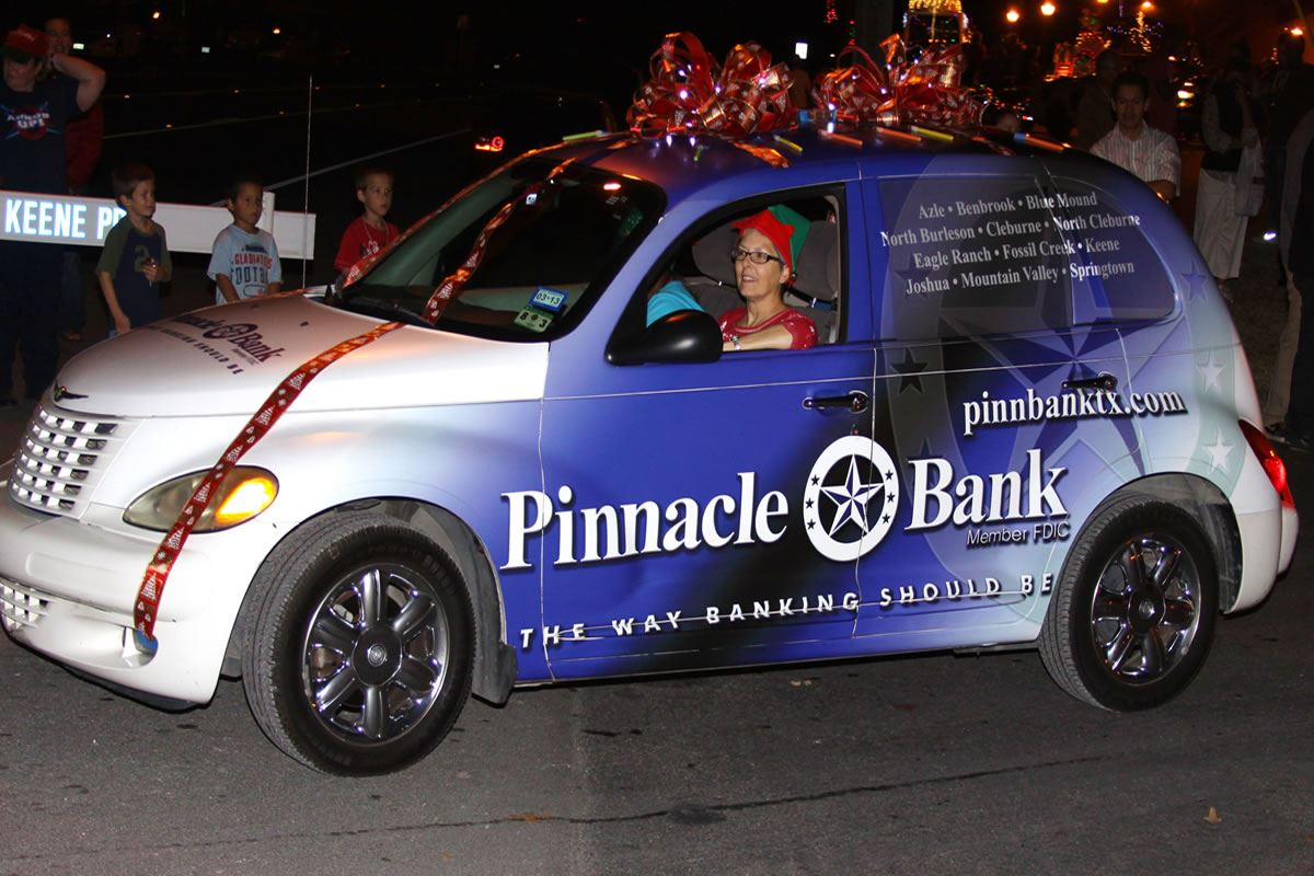 Woman Drives Pinnacle Bank Holiday-Decorated PT Cruiser